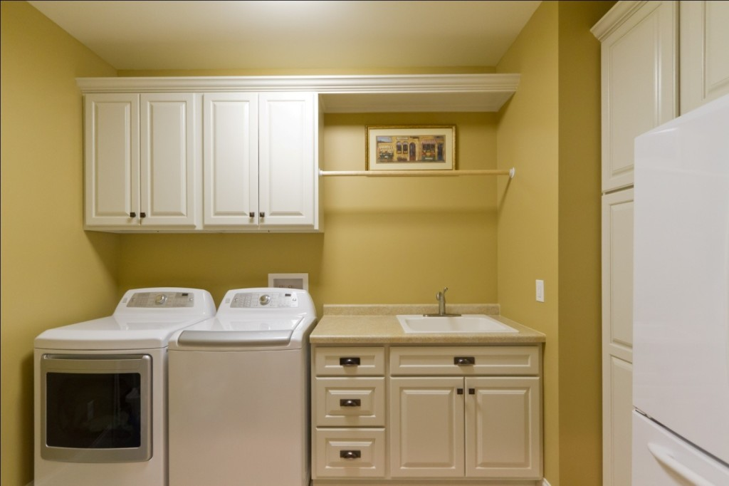 wooden or steel cabinets in utility room