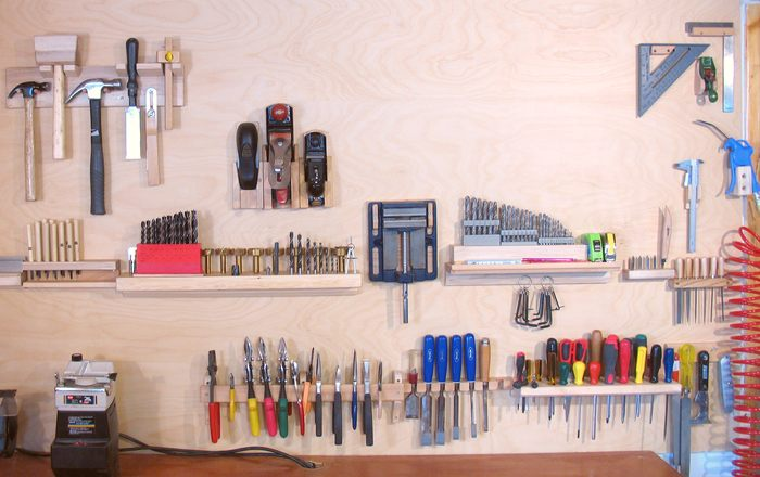 Folding pegboard cabinet
