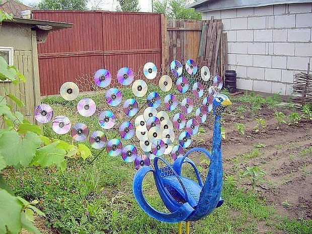 Garden Art Ideas crystal drip can yard art from Cd Peacock