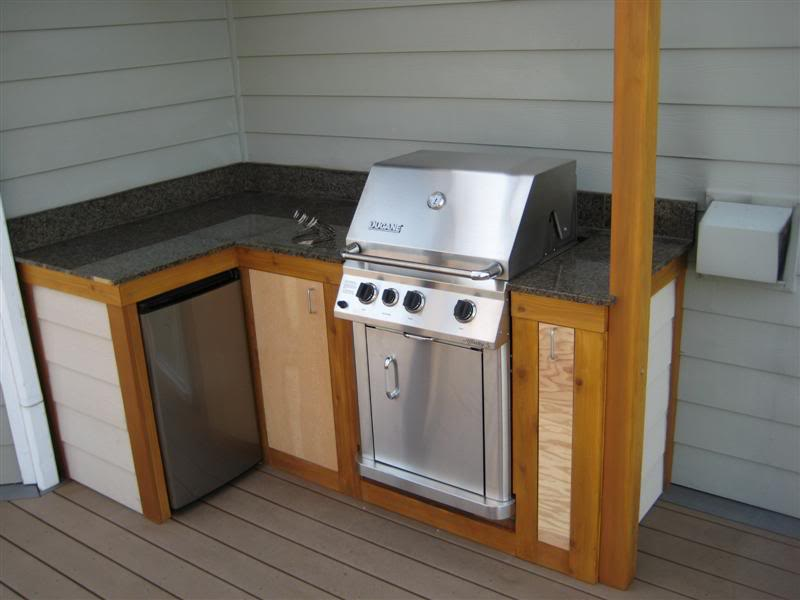 10 outdoor kitchen plans turn your backyard into for Outdoor grill cabinet design